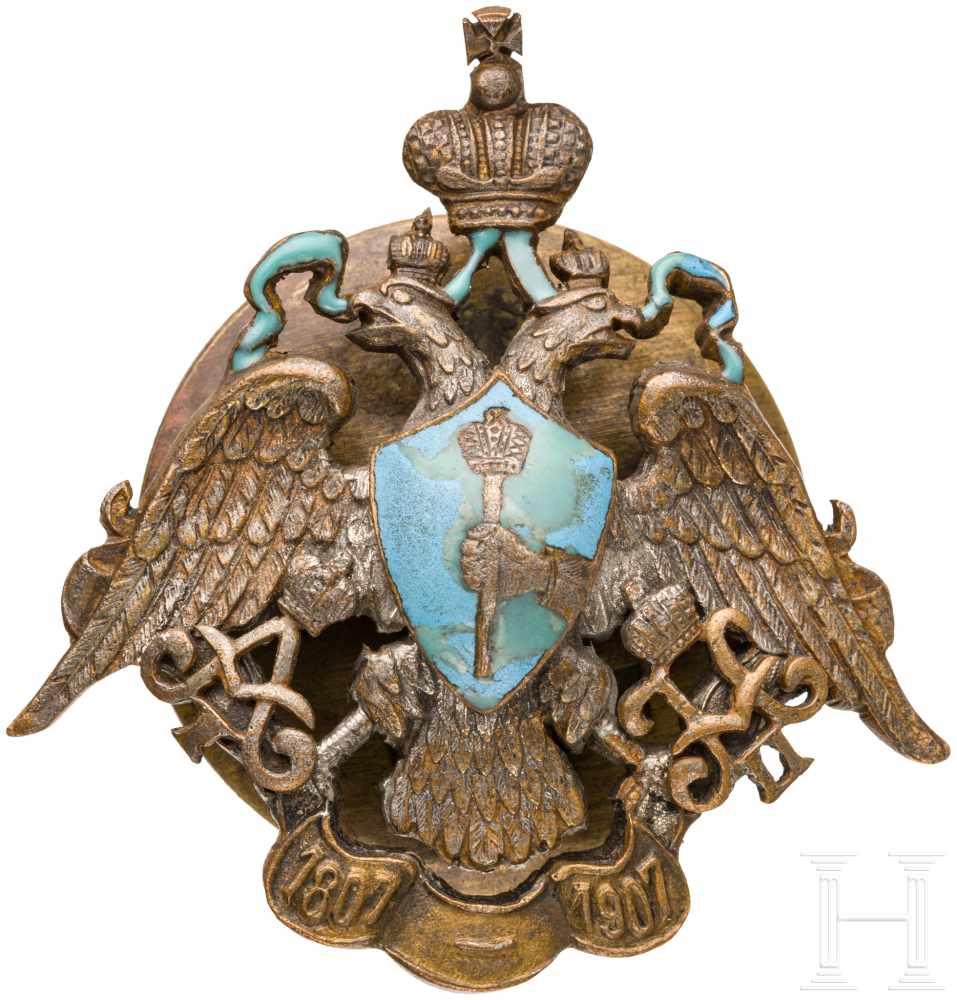 Lot 3894 - Abzeichen des 24. Lubensky Dragonerregiments, um 1910Bronze, teils emailliert, rs. Reste der
