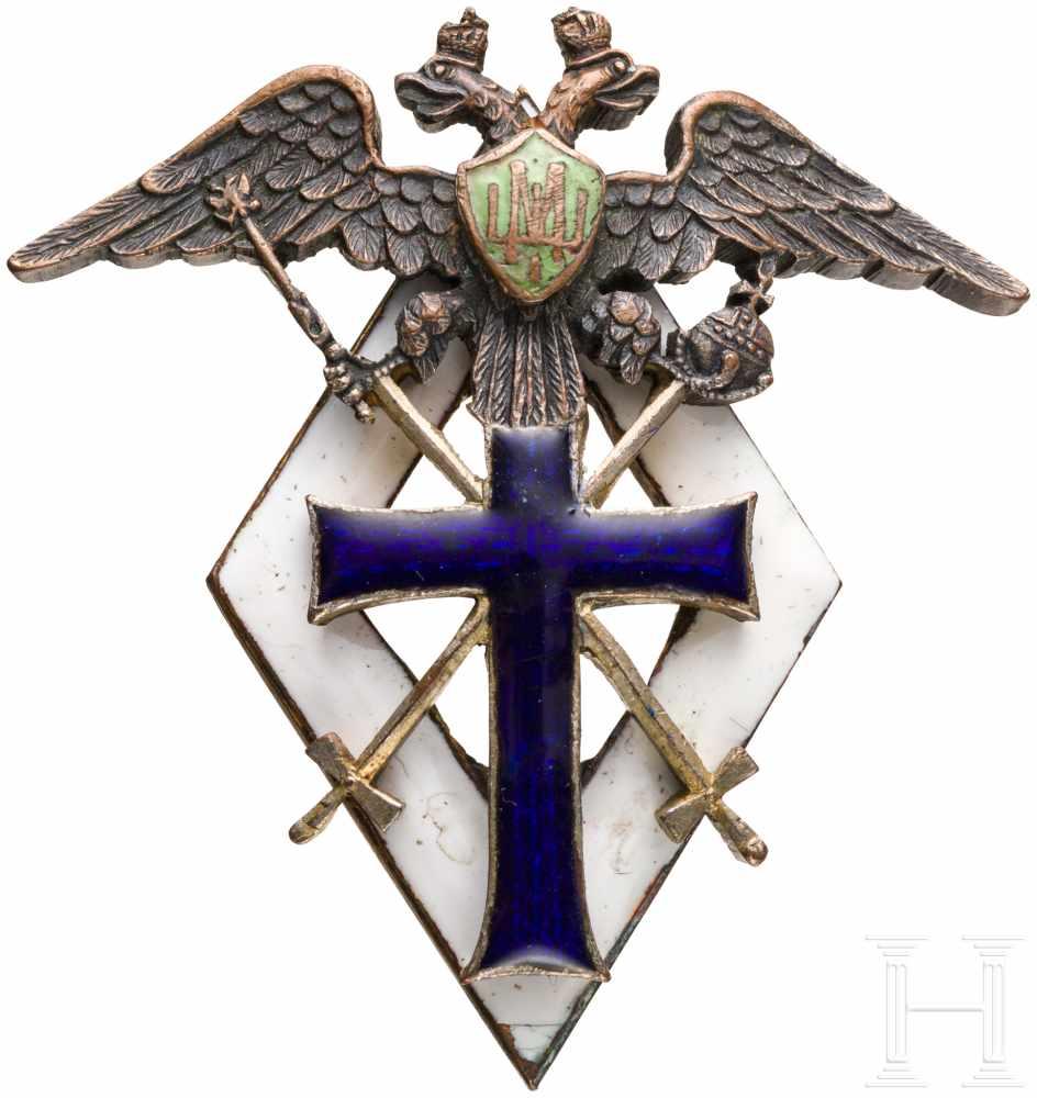 Lot 3895 - Absolventenabzeichen der 1. Moskauer Schule für Fähnriche, um 1915Bronze, teils vergoldet,