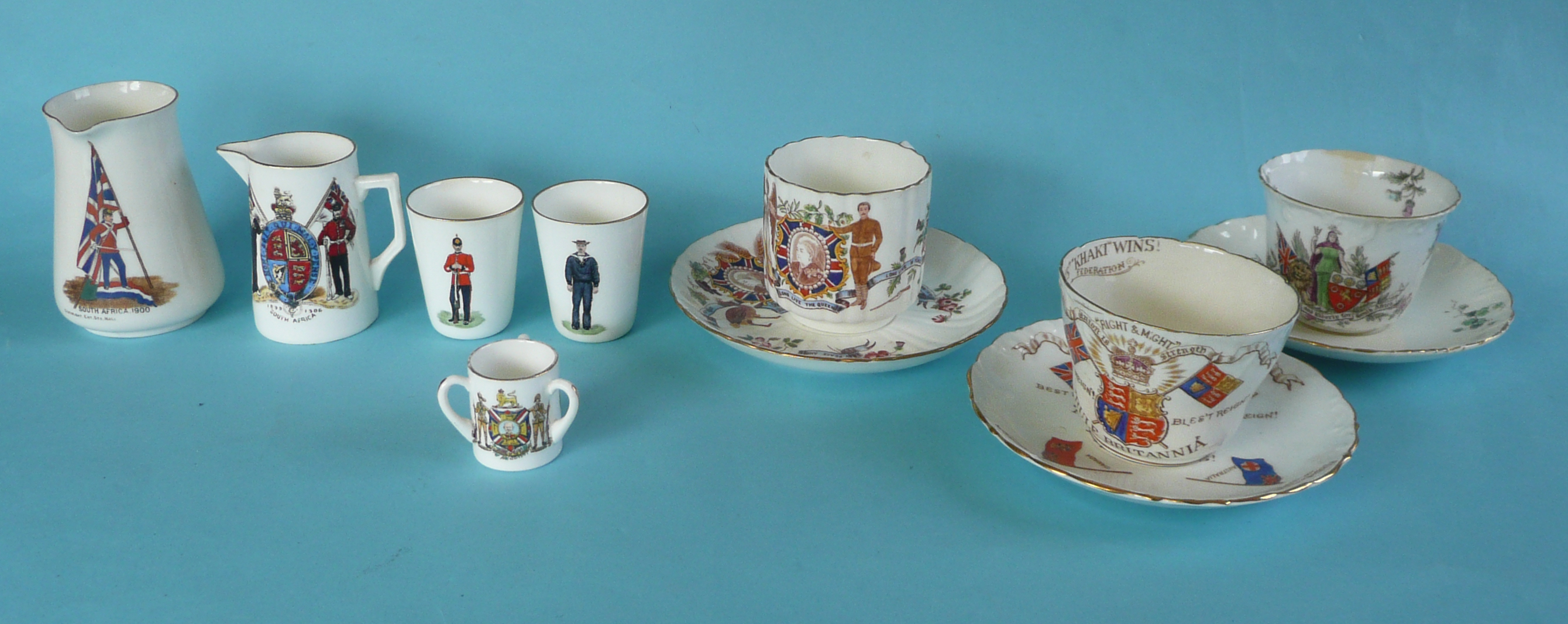 Lot 51 - Boer War: two small jugs, a pair of miniature beakers, a miniature Foley tyg and three cups and