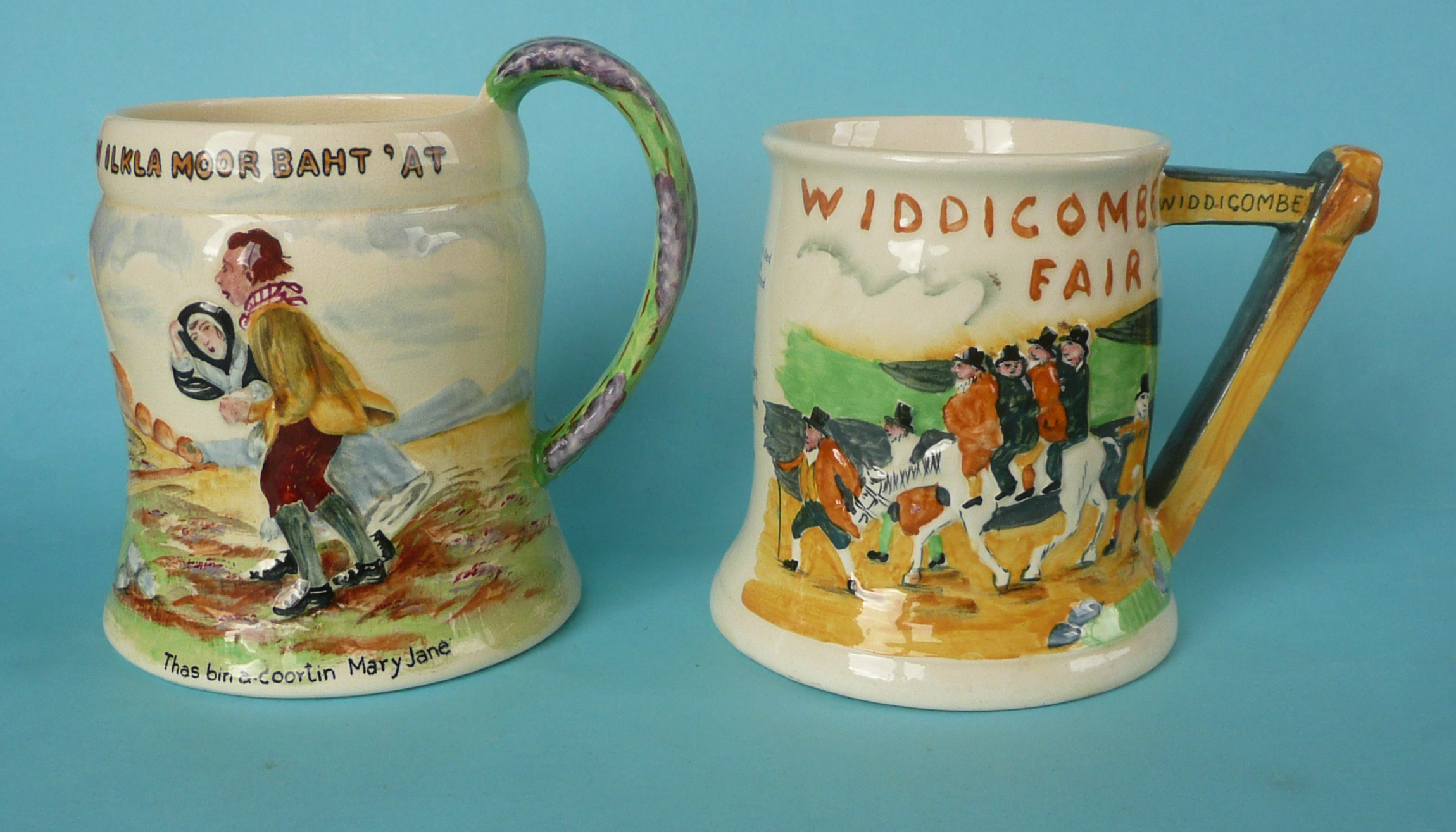 Lot 1 - A good Ilkla Moor musical jug, 140mm and a good Widdicombe Fair jug, both by Crown Devon and working