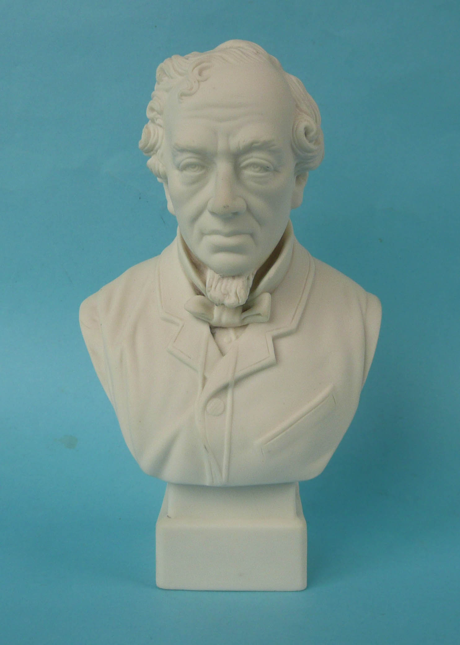 Lot 32 - Disraeli: a white parian portrait bust by Robinson & Leadbeater on integral square base, 261mm (