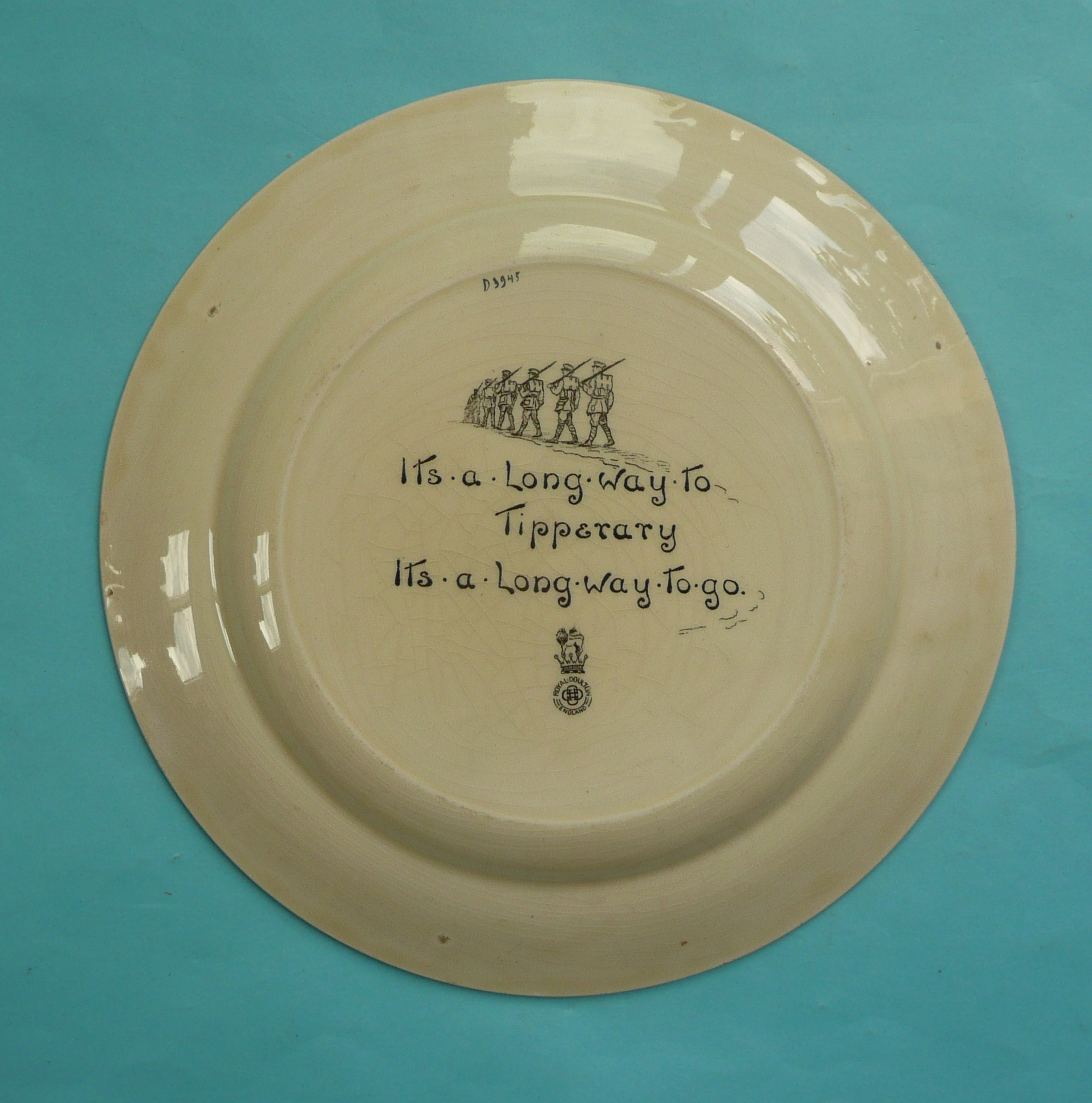 Lot 56 - World War I: a Royal Doulton plate stylishly decorated with a soldier against the Union flag, the