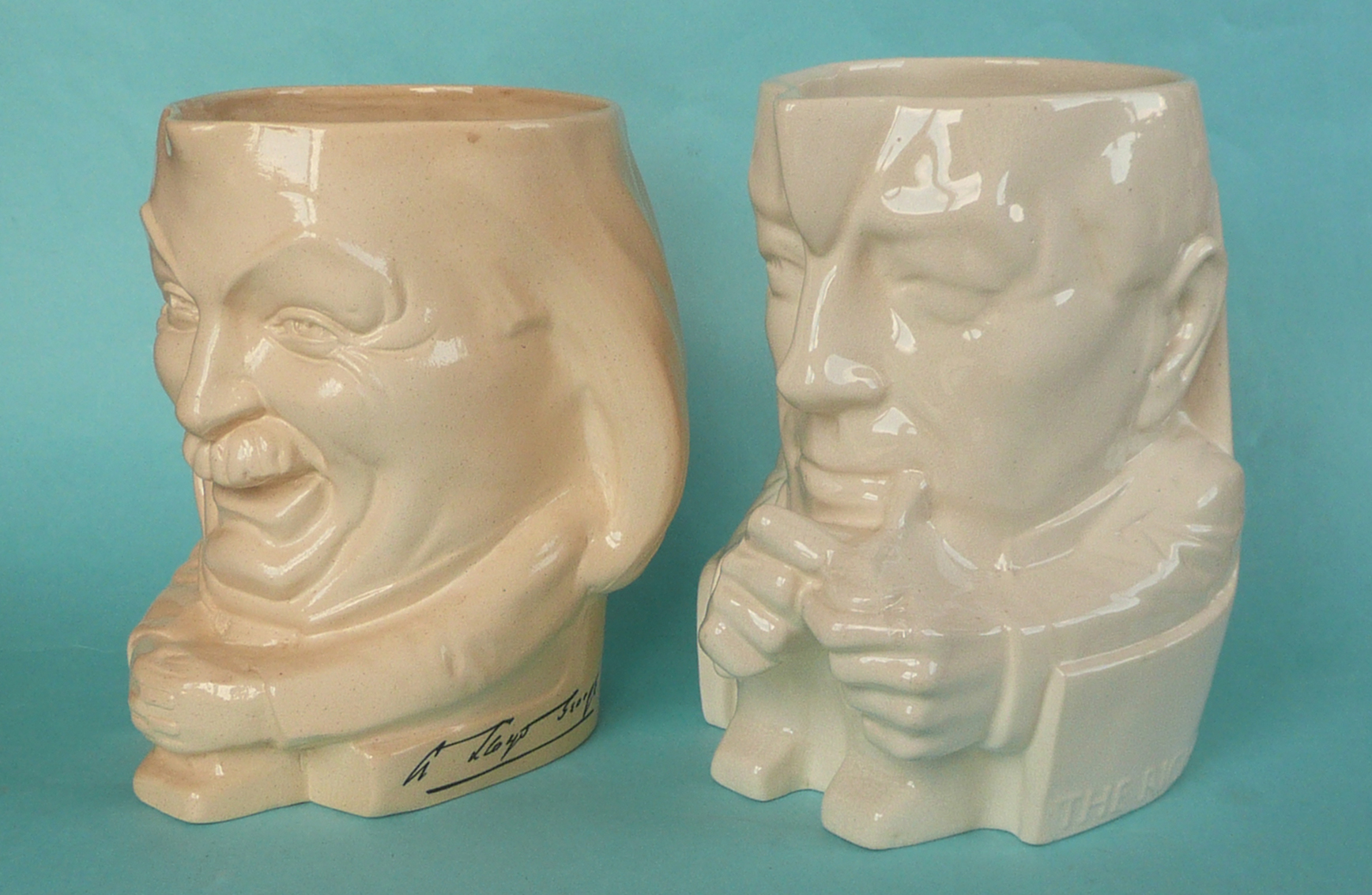 Lot 38 - An Ashstead pottery jug by Percy Metcalfe depicting Lloyd George, 182mm and another depicting