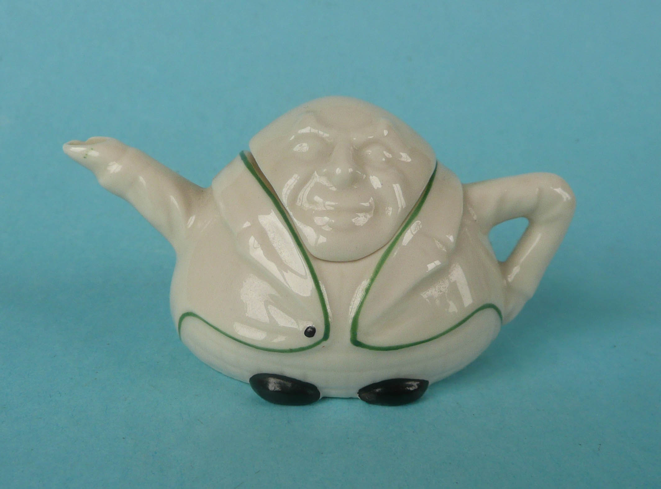 Lot 47 - President Paul Kruger: a miniature teapot and cover by Grafton China, 48mm (2) (commemorative,