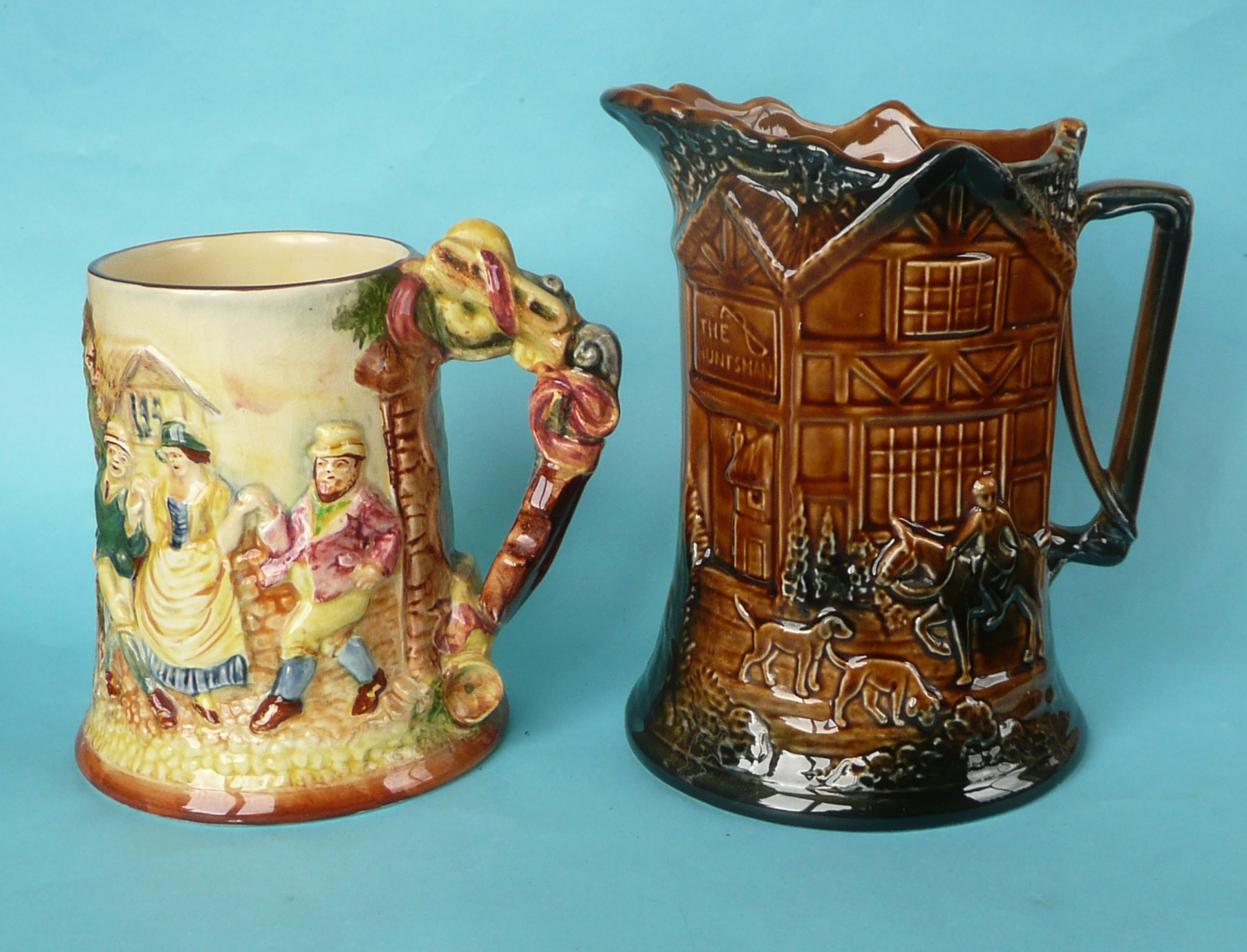 Lot 10 - A good Floral Dance musical mug, 172mm and a treacle glazed musical moulded jug to play John Peel,