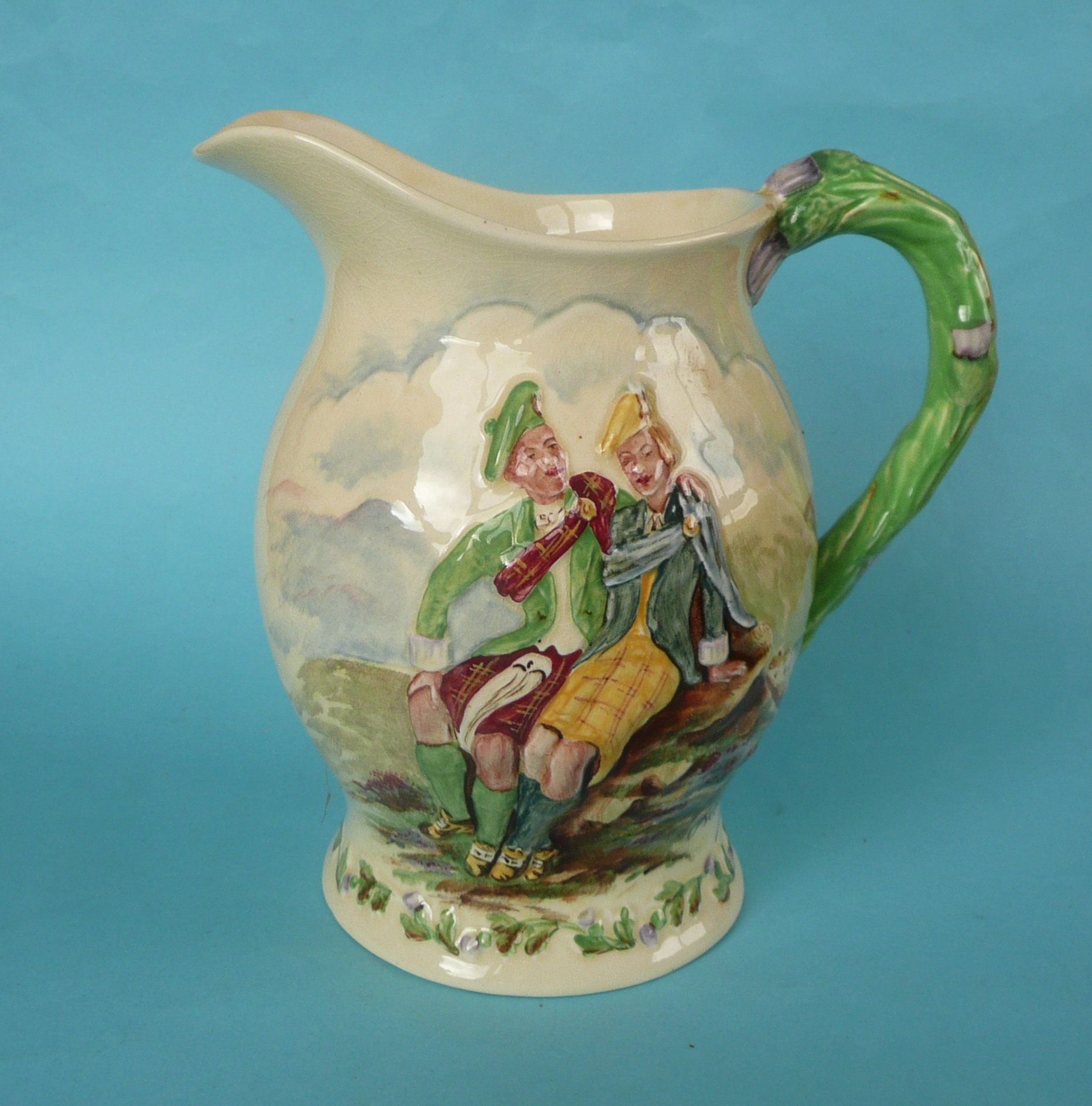 Lot 16 - A good Crown Devon Roamin in the Gloamin musical jug to play that air, 201mm