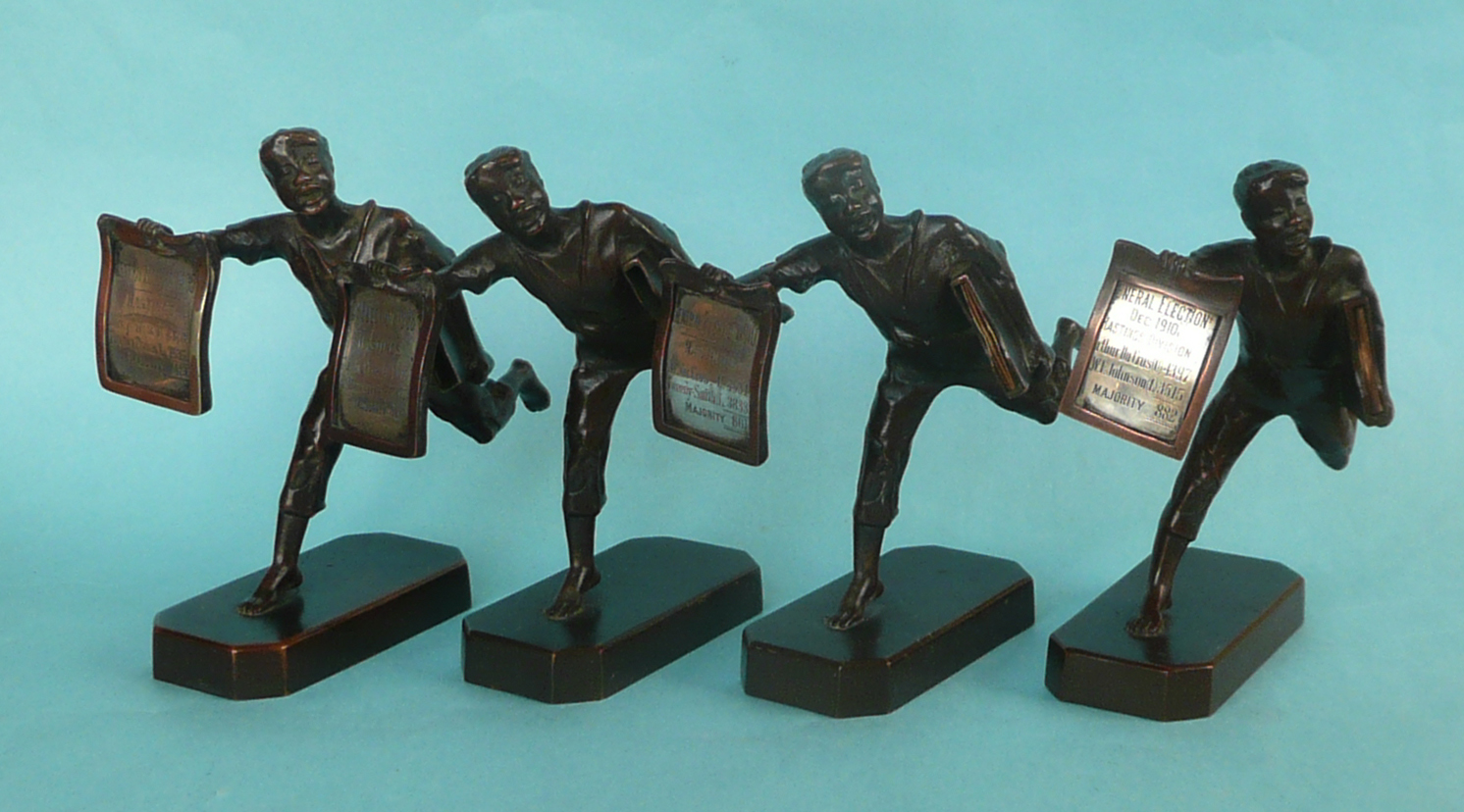 Lot 35 - 1906 to 1910 Elections in Hastings and Ducross: four bronze figures by Elkington & Co depicting