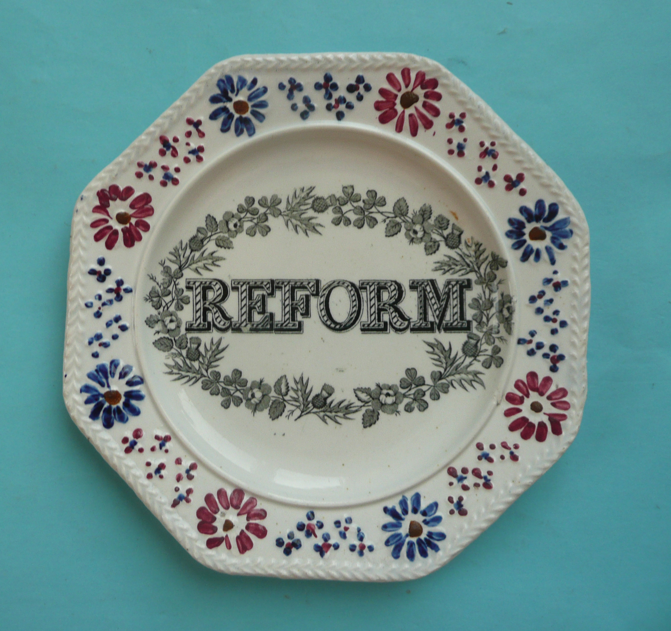 Lot 41 - 1832 Reform: an octagonal nursery plate with colourful moulded border, 178mm (commemorative,