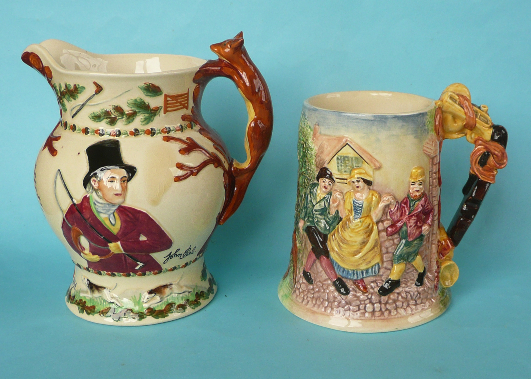 Lot 9 - A Crown Devon John Peel musical jug to play that air, 195mm, the replacement movement detached and a