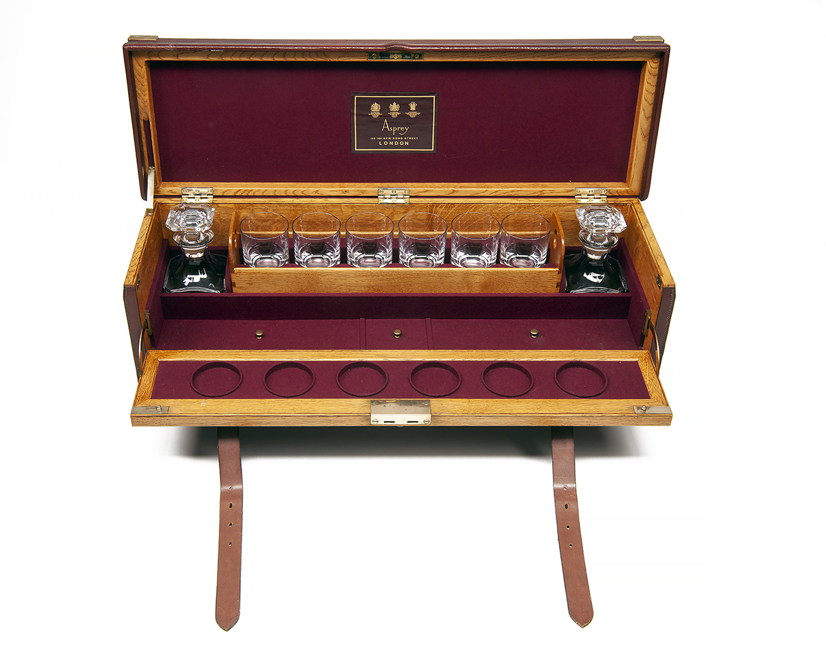 Lot 750 - ASPREY A FINE BRASS-CORNERED OAK AND LEATHER PORTABLE DRINKS CABINET, approx. 31in. x 9 1/2in. x