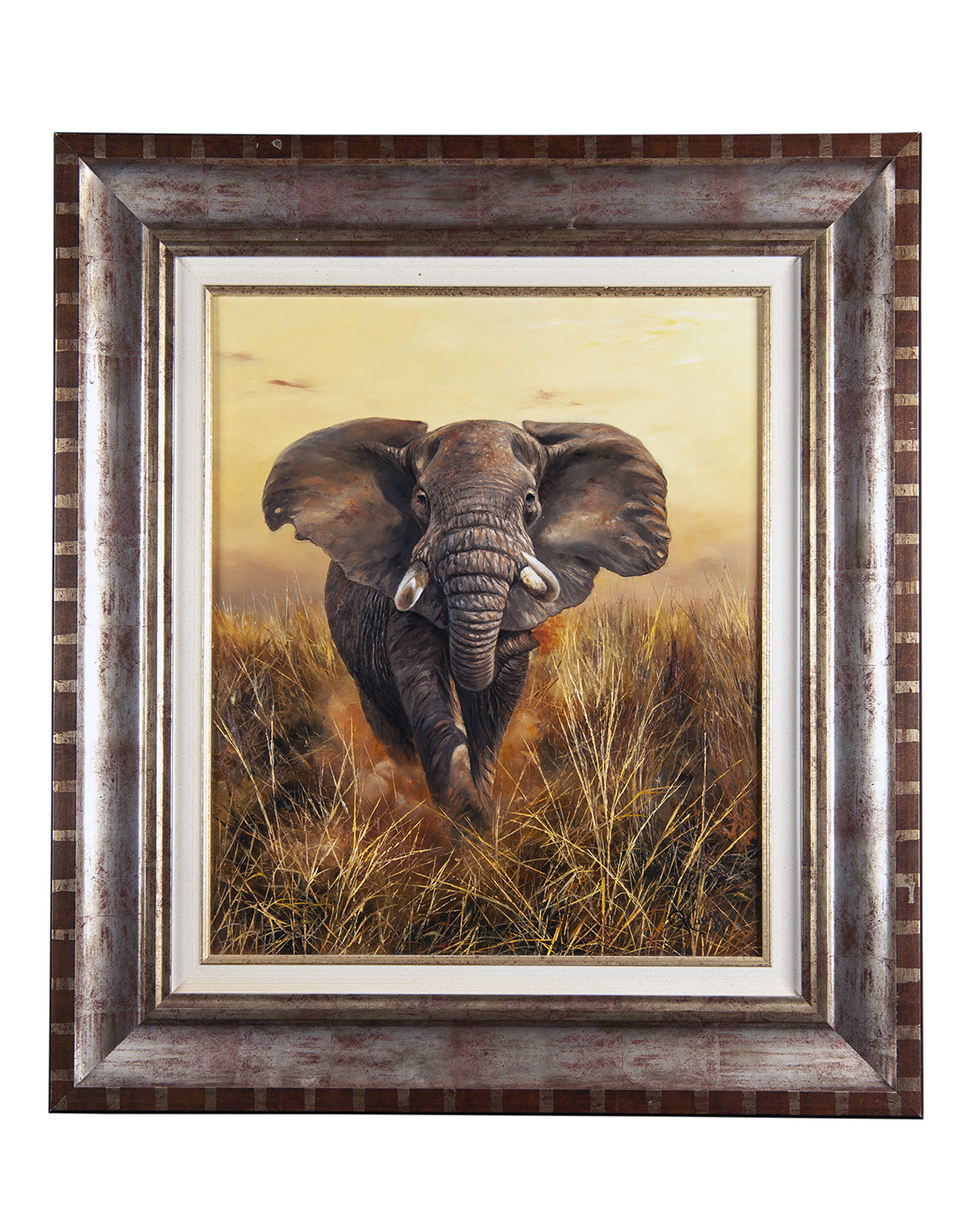 Lot 104 - PIERRE COUZY AN ORIGINAL OIL ON CANVAS OF A CHARGING BULL ELEPHANT, signed by the artist, set in a