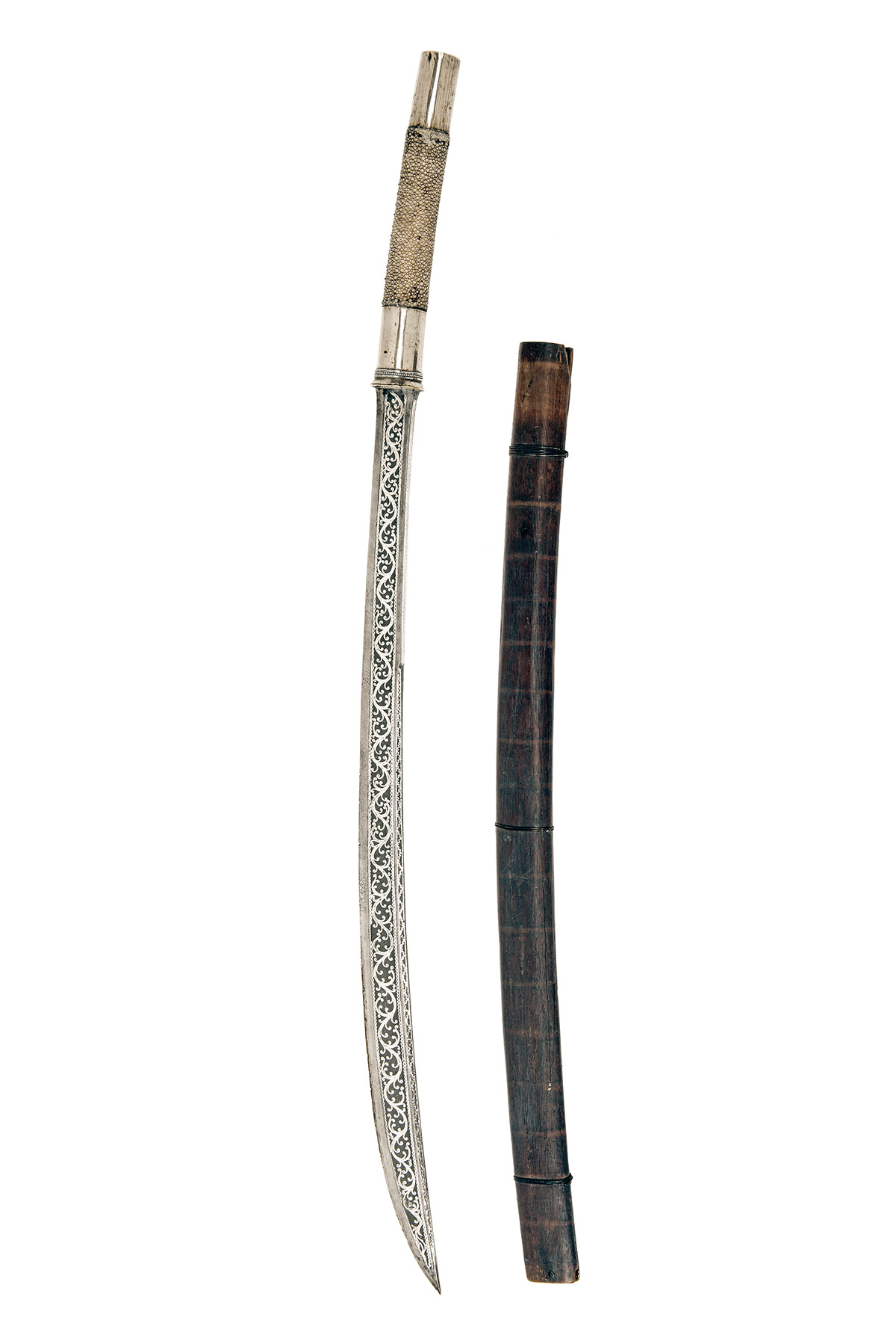 Lot 212 - A WHITE-METAL AND KOFTGARI DECORATED BURMESE DHA, late 19th century, with curving spear-point