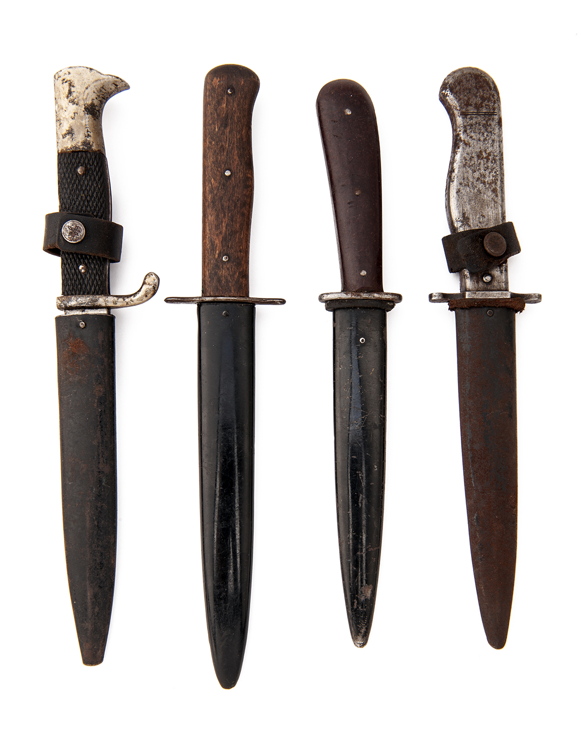 Lot 220 - FOUR GERMAN WORLD WAR ONE AND TWO BOOT or TRENCH-KNIVES, ONE SIGNED 'PUMA', various blade types,