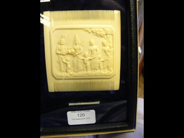 Lot 120 - A carved ivory comb with relief work to the centre