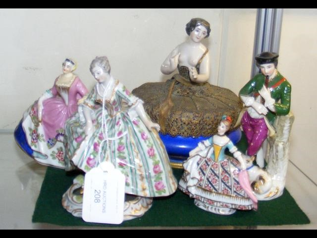 Lot 208 - A ceramic dancing figurine with glass to the base,
