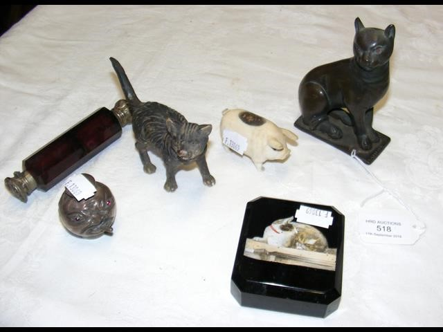 Lot 518 - An ivory pig pin cushion together with novelty sil