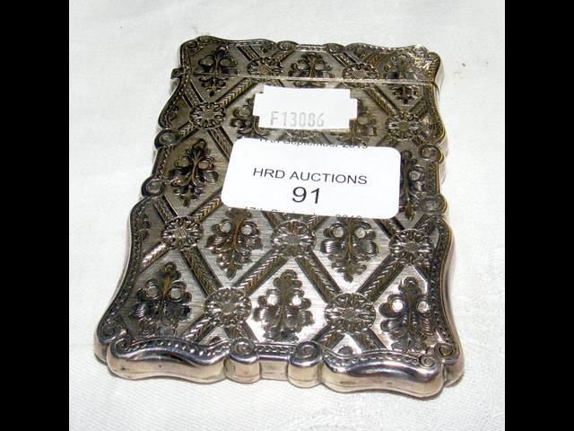 Lot 91 - A silver card case with engraved decoration - 9.5x