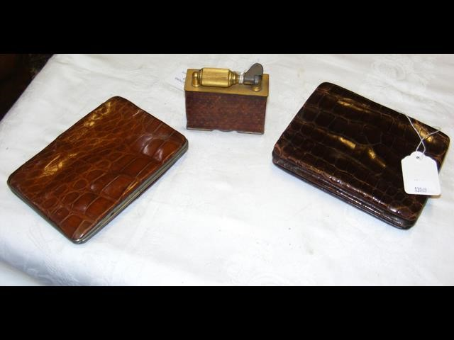 Lot 527 - A vintage McMurdo table lighter, together with two