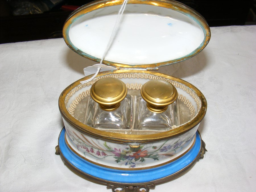 Lot 122 - An antique porcelain and gilt mounted oval two bot