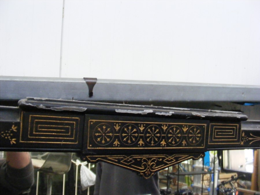 Lot 26 - A Victorian aesthetic style ebonised overmantel wi