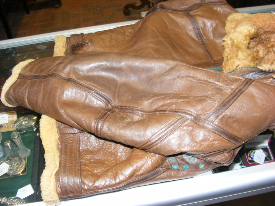 Lot 37 - A vintage sheepskin lined brown leather flying jac