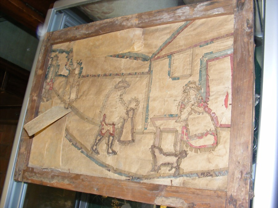 Lot 7 - An antique embroidery depicting figures - possibly