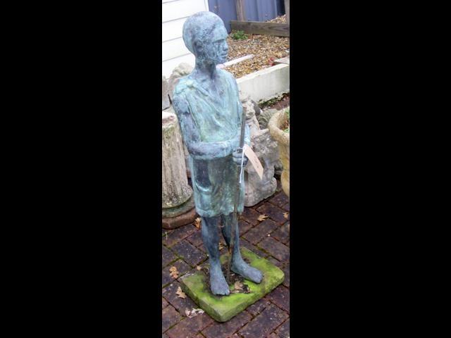 Lot 8 - A resin garden ornament of African man
