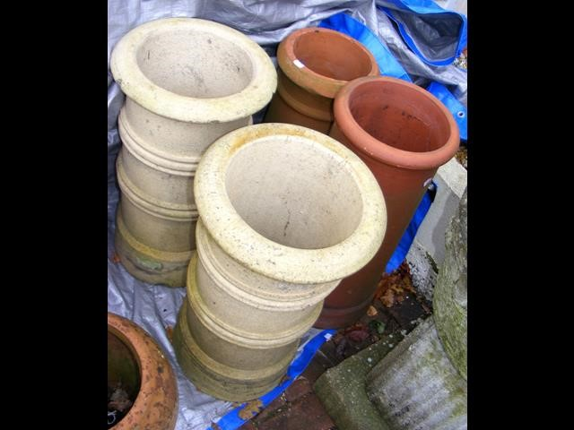 Lot 1 - Two old terracotta chimney pots and two others