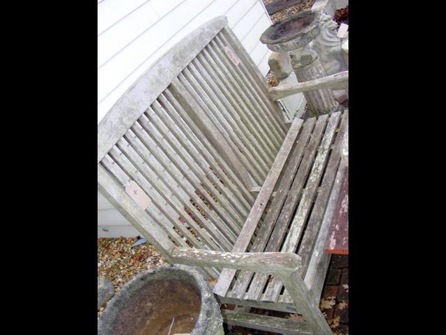 Lot 4 - A high back teak garden bench