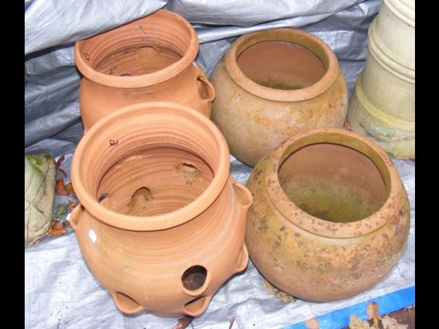 Lot 2 - Two terracotta pots, together with two terracotta