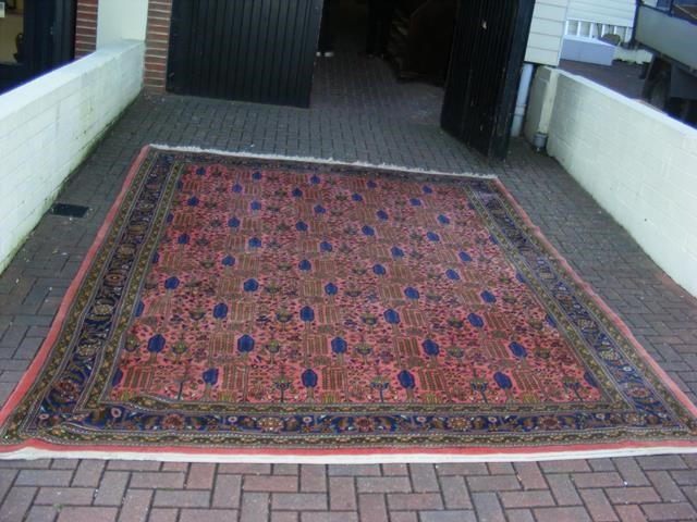 Lot 36 - Antique Middle Eastern carpet with geometric borde