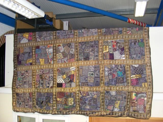 Lot 24 - A large and decorative embroidery work with panels