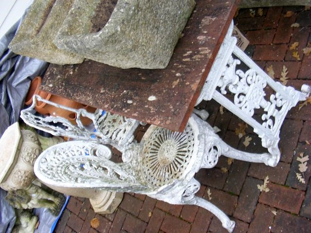 Lot 6 - A garden table with two chairs