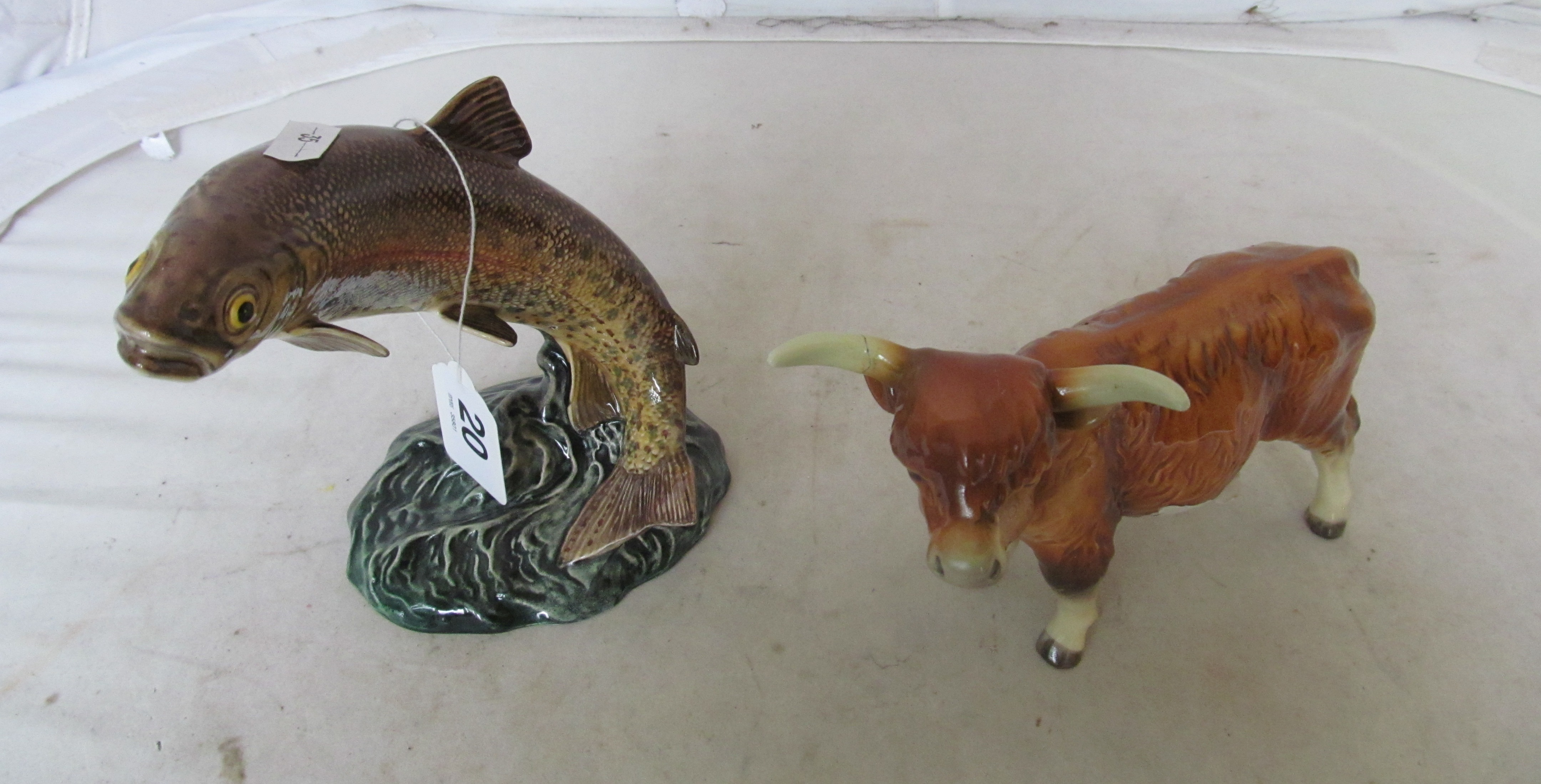Lot 20 - A Goebbel model Highland cow (horn a/f) and a Beswick leaping trout (tail repaired)