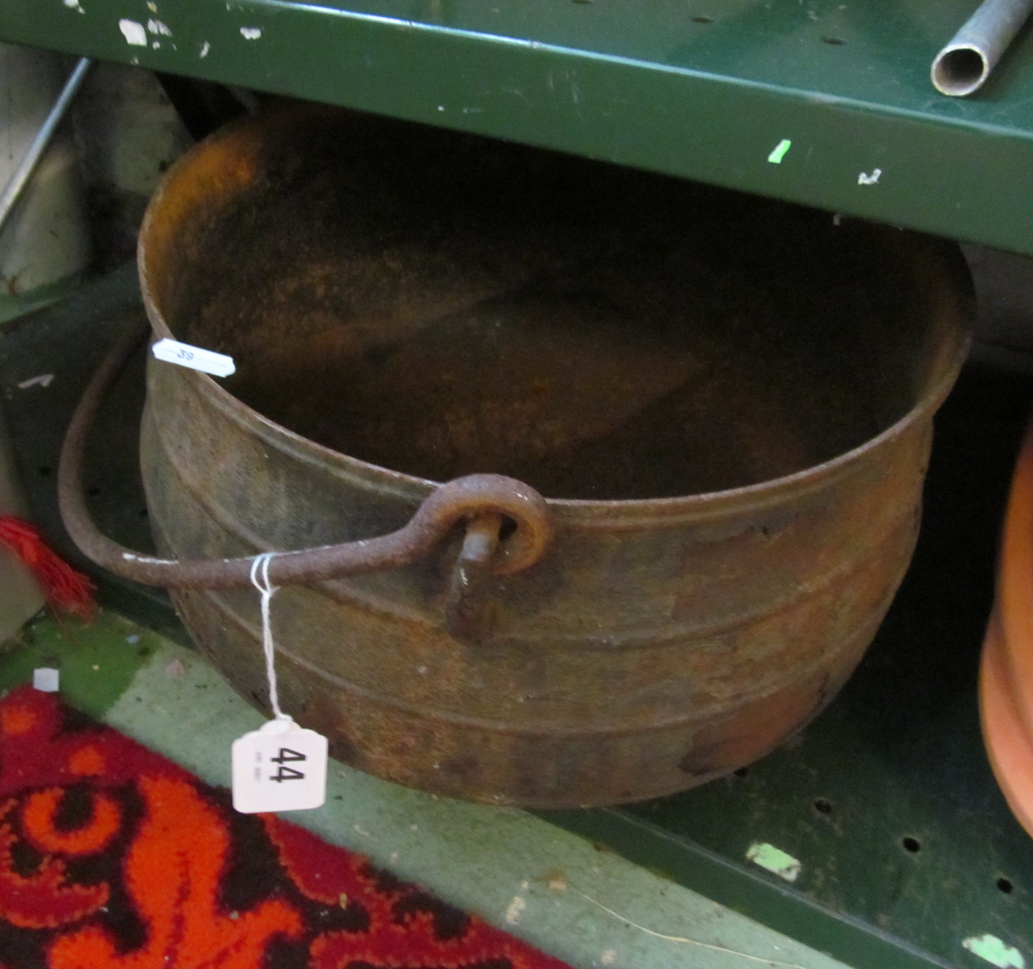 Lot 44 - A metal cauldron