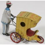 Lot 11 - A STRAUSS TIN LITHO WIND-UP ROLLO-CHAIR