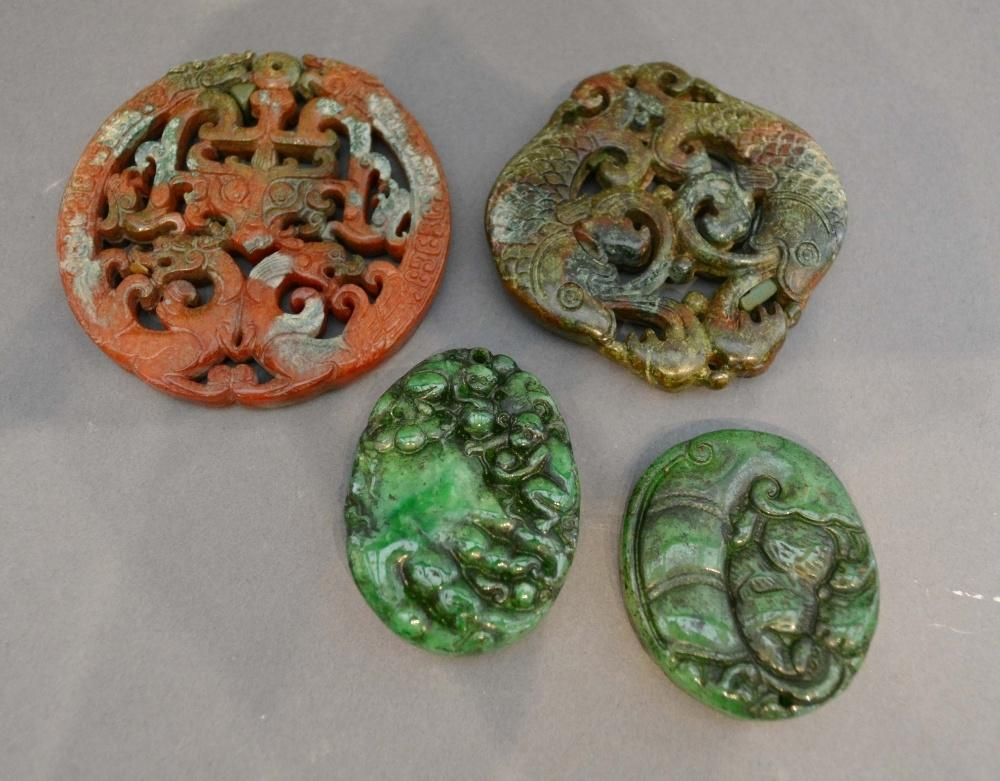 Lot 274 - A Chinese Stone Pendant of Pierced Form, together with another similar and two similar jade pendants