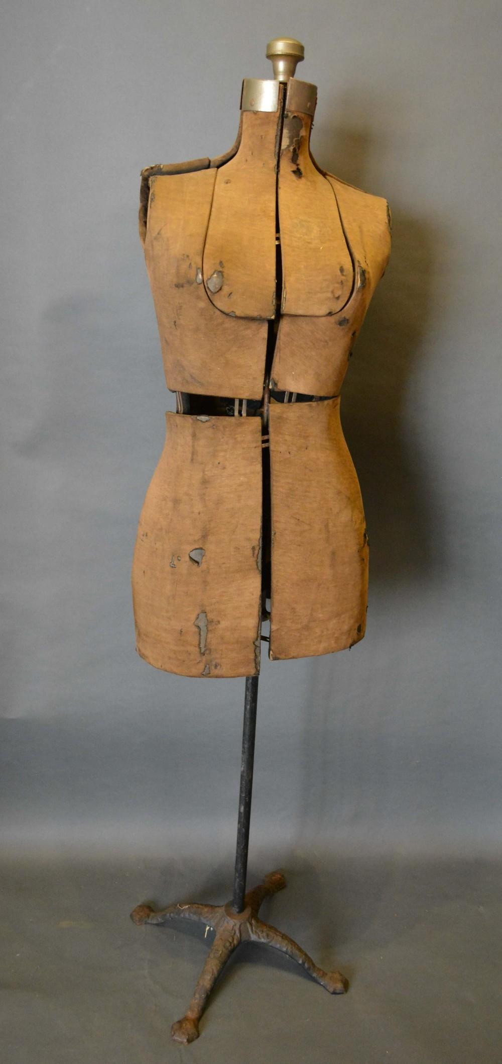 Lot 297 - An Early Tailors Dummy with wrought iron stand, 150cm tall