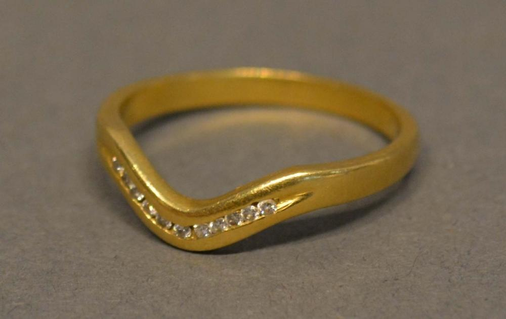 Lot 202 - An 18 Carat Yellow Gold Diamond Set Wishbone Ring