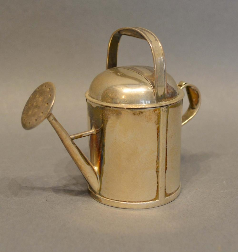 Lot 193 - A Victorian London Silver Perfume Bottle in the form of a watering can, retailed by Andrew Barrett &