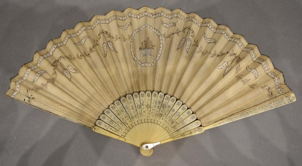 Lot 319 - An Early 18th Century Paper Leaf Fan painted with bows and swags and mounted with sequins, the ivory