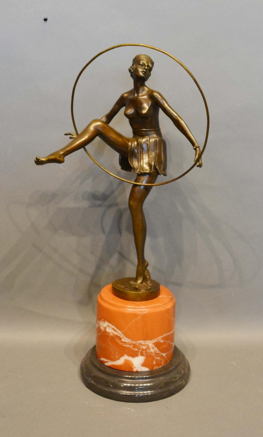 Lot 301 - An Art Deco Style Patinated Bronze Model in the Form of a Dancing Girl with Hoop upon variegated