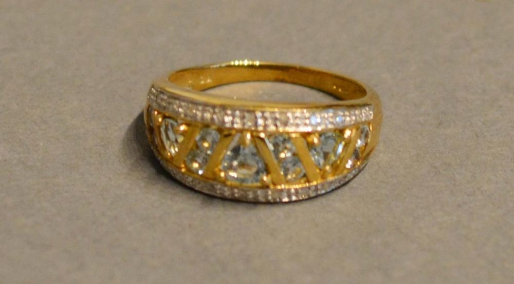 Lot 164 - A 9 Carat Gold Pale Sapphire and Diamond Set Band Ring of pierced form