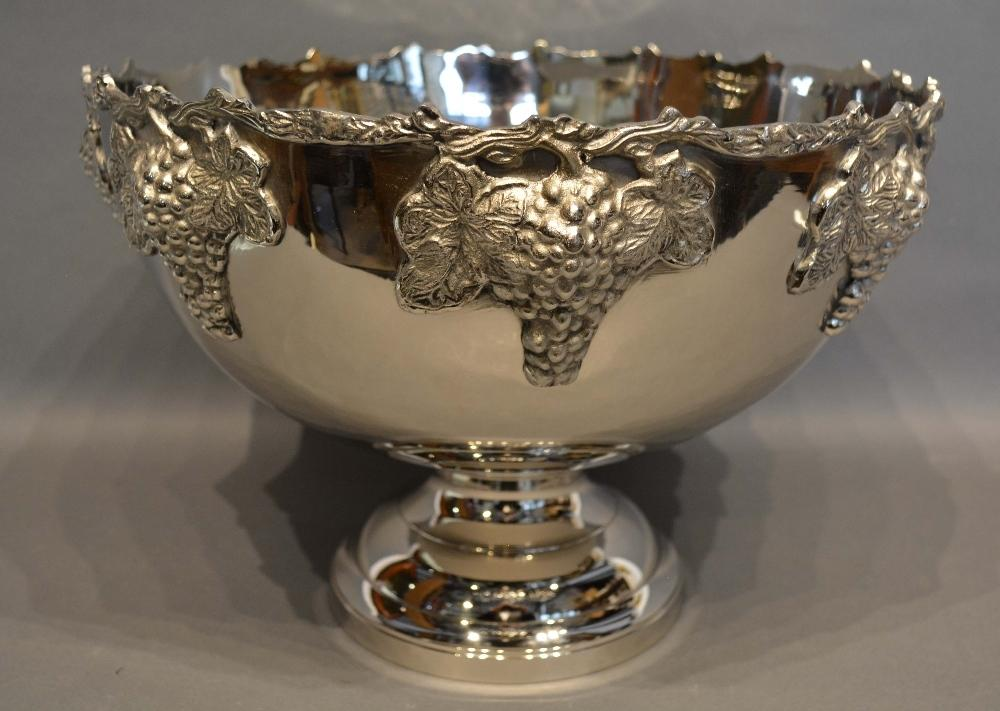 Lot 205 - A Silver Plated Large Punch Bowl decorated in relief with grape vines, 39cm diameter