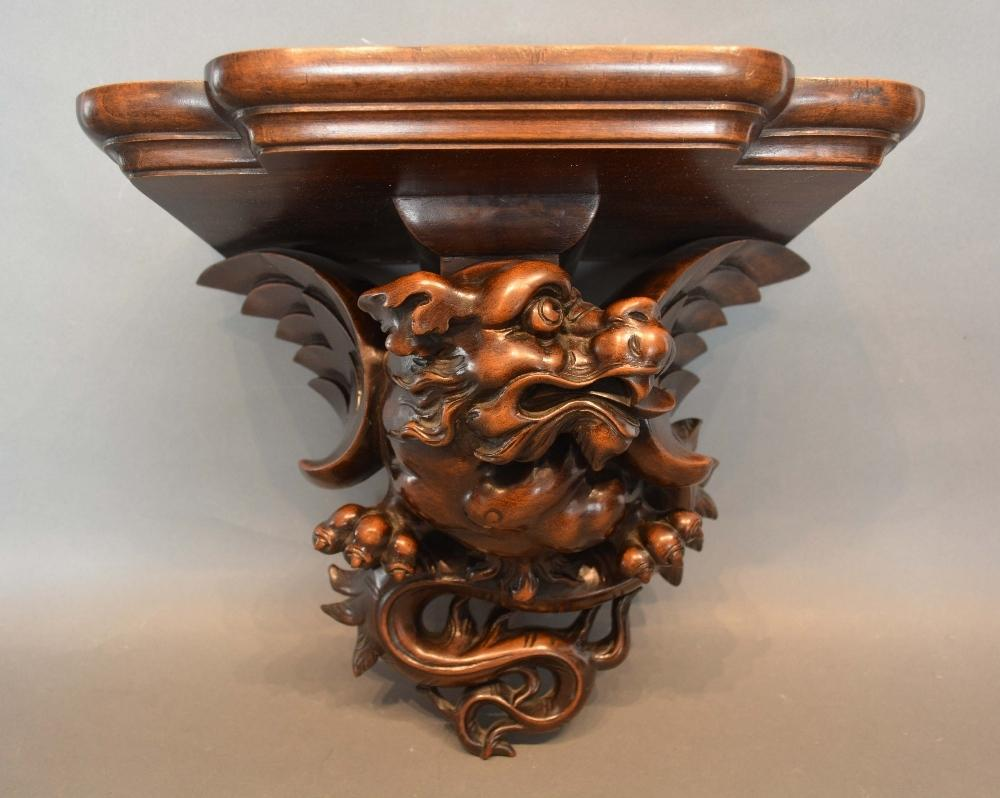 Lot 227 - A Late 19th/Early 20th Century Chinese Hardwood Clock Bracket in the form of a winged serpent,