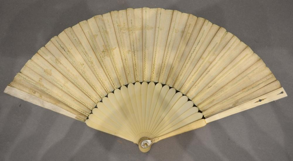 Lot 318 - An 18th Century Ivory and Vellum Leafed Fan with ivory sticks and ivory and mother of pearl