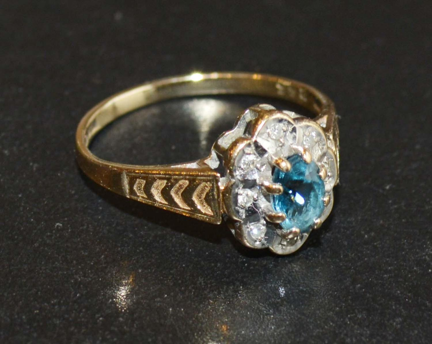 Lot 220 - A 9 Carat Gold Aquamarine and Diamond Ring set with an oval aquamarine and surrounded by diamonds