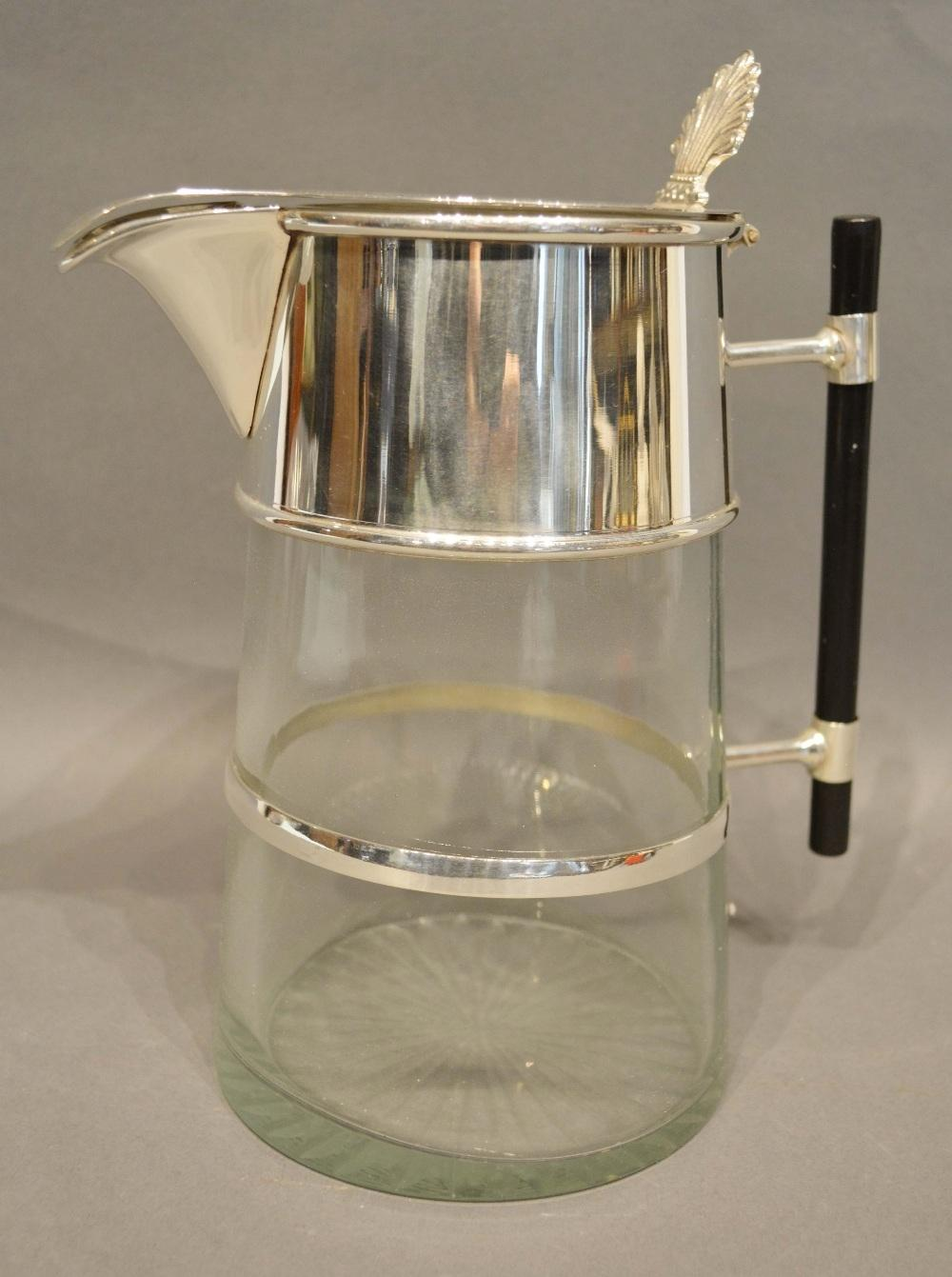 Lot 206 - In the Style of Christopher Dresser, a Silver Plated and Glass Claret Jug with stylised handle, 24cm