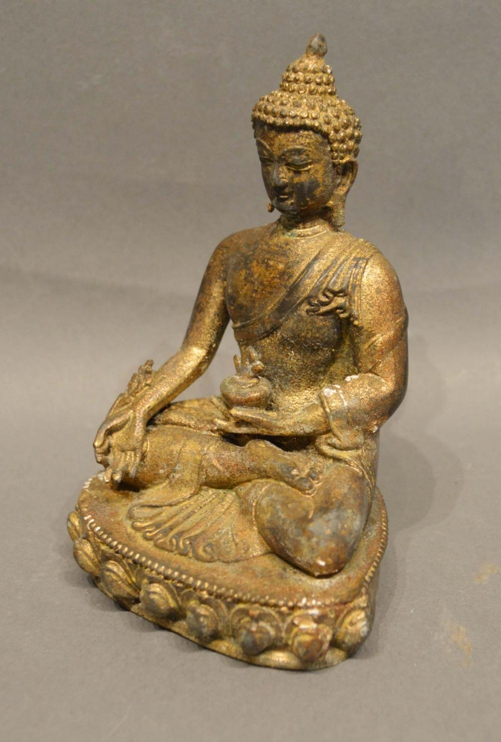 Lot 288 - A Patinated Bronze Model in the Form of Buddha, 13cm tall
