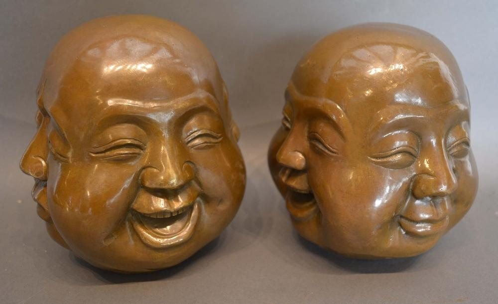 Lot 267 - A Pair of Japanese Patinated Bronze Busts, The Four Faces, 16cm tall